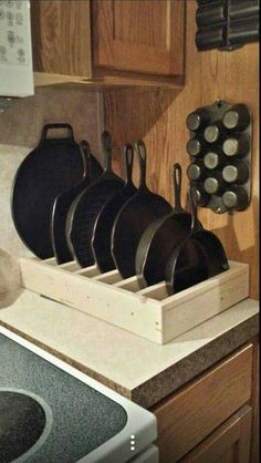 Cast Iron Pan Holder. Top 23 Cool DIY Kitchen Pallets Ideas You Should Not Miss