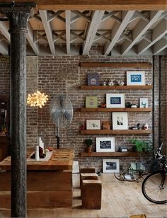 Brickwall with shelves, which allow to reorganize frames& photos whenever you want