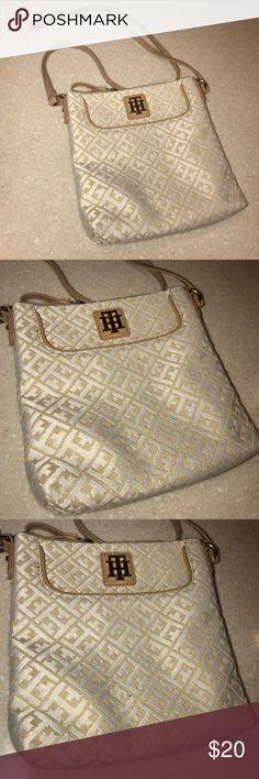 Tommy Hilfiger crossbody Has few used only,has 2 tiny dot of Brown in front that hardly noticed. Tommy Hilfiger Bags Crossbody Bags