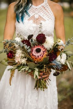 Flowers by Lace and Lilies, white, burgundy, blue bouquet with pink protea, dahlia, thistle, magnolia, blushing bride and amaranthus. Mountain wedding. Blue hair