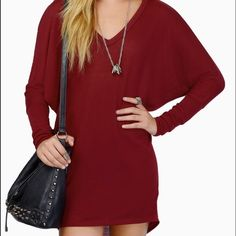 "BNWOT ""Live in the Moment"" Tunic Maroon sweater dress, v neck, long sleeve, slightly high/low hem, color is slightly darker than the online picture. Very soft, not thick, very flattering for all body types Tobi Dresses Long Sleeve"