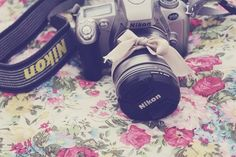 a bow makes everything look pretty.  ^^ & of course it's a Nikon which makes it even more perfect<3 (;