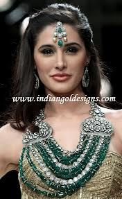 "Nargis wearing one of our master pieces from ""the Panna collection"" at IIJW fashion show Mumbai, 2012.."