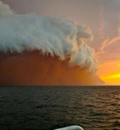 A huge wave of dust swept over the coast of Western Australia on Wednesday, Jan. 9,2013. A Bureau of Meteorology forecaster explained to The West Australian that the striking view was created when the sand and dust was mixed into a thunderstorm's wind and rain.