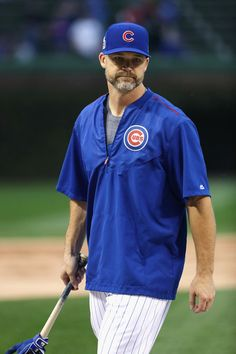 David Ross #3 of the Chicago Cubs warms up before Game Four of the 2016 World Series against the Cleveland Indians at Wrigley Field on October 29, 2016 in Chicago, Illinois.