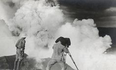 A photographer and a geologist photograph the Taal volcano erupting in the Philippines, April 1912.