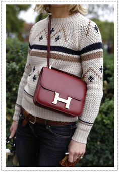 In love with this sweater and purse.