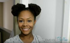 Give a little #tbt shoutout with some afro puffs and a zig-zag part.
