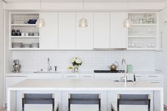 Installation Inspiration - Heath Ceramics. White cabinets, shelves at ends with tile backlash