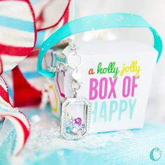 Here's your *exclusive* first look at the new Heritage Living Locket, framed beautifully with Crystals by Swarovski! Each Origami Owl Living Lockets holiday purchase comes in its own little Holly Jolly Box of Happy! Do you love it!?