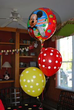 Decorated with red and yellow polka dotted ballons from Party City