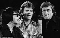 Roy Orbison, John Fogerty and Johnny Cash.