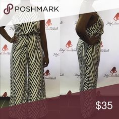 NWT Zebra Print Pant Jumper New pant jumper with tie neck, and open back. Fit is true to size. Pants Jumpsuits & Rompers