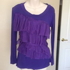 """M by MISSONI denim Ruffle long sleeve top This is a M by Missoni denim ruffle top. It is dark purple with multi tier Ruffles on the front. Ties at the waist. Long sleeve. Gently used condition. Size medium. Bust 36"""" length 25"""". M by Missoni Tops Blouses"""
