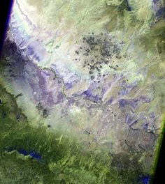 Landsat 5's Thematic Mapper can take both natural-color images and images in parts of the light spectrum that we can't see, such as in this image. Different types of rock, plants and soil can be seen better in these spectral bands. And the result is often a beautiful, colorful image.
