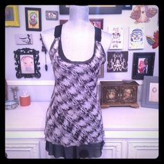 ✂️✂️ Clearance Barney's Coop Black  sheer tank Cool racer bank tank from Barney's Coop line. Adjustable strapless with oversized hardware, two layers of sheer fabric, bottom layer is black, top has a black white and grey abstract pattern, slightly longer length, more like a tunic.  Small stain on front see pic 4. ** Please ask all questions before purchase. All items sold as is. Barneys New York CO-OP Tops Tank Tops