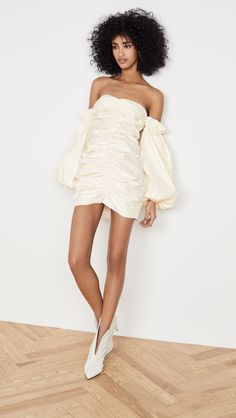 This unique mini wedding dress from Rotate is serving all of the trends! From the off-the-shoulder style, and puffed sleeves, to the ruched bodice, you just cant go wrong! Plus, its the perfect fit for a modern (or even vintage-inspired!) fall wedding. Click the link for more unique short wedding dresses. // Photo: Shopbop