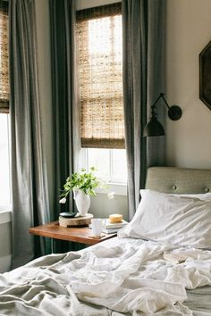 I love the mix of natural shades and velvet curtains. Via Rambling Renovators