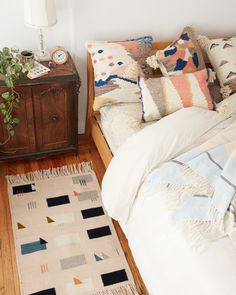 love the different colors in the pillows and the rug they all go really well with eachother