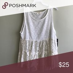Lace Trim White Sleeveless Bohemian Top Bringing romance back with this white sleeveless top.  Features a flared fit with lace detailing under bust to hem.  Nylon/Spandex  Trim: Cotton/Nylon Tops