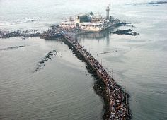 The Haji Ali Dargah is a mosque and dargah (tomb) located on an islet off the coast of Worli in the Southern part of Mumbai. Near the heart of the city proper, the Dargah is one of the most recognisable landmarks of Mumbai.