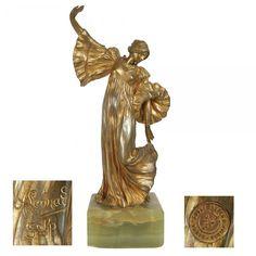 "AGATHON LEONARD (1841-1923) - "" Danseuse a la Cothurne "". Escultura em bronze dourado."