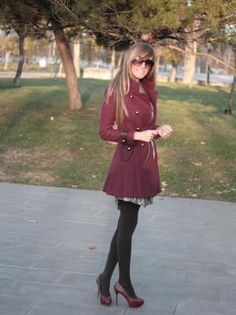 black pantyhose and burgundy pumps