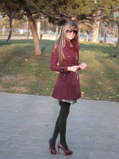 black pantyhose and burgundy pumps