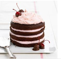 Chocolate-Cherry Stack Cake A creamy layer of cherry-flavor frosting between each tier of rich chocolate cake makes this dessert unforgettable. Chocolate-covered cherries make a gorgeous topper.