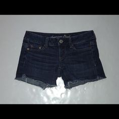 """American Eagle Dark wash denim shorts Size 00 5 pockets, frayed hems, low rise, cotton blend. Waist is 29-30"""", rise is 6"""", length is 10"""" and the inseam is 3.5"""". American Eagle Outfitters Shorts Jean Shorts"""