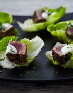 This pretty Asian-inspired canapé will keep your guests coming back for more - tuna is given a black peppercorn crust and served with creamy mayo on crisp lettuce.