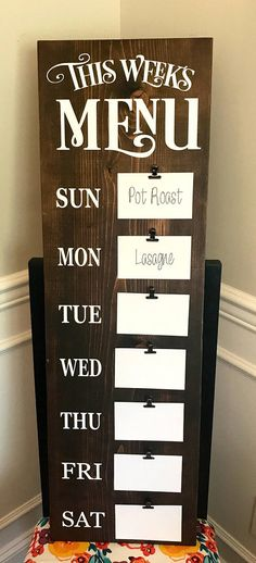 Menu Board , Meal Planning Sign, Weekly Meal Planning, Kitchen Decor, Wooden Kitchen Sign, Farmhouse Decor, Fixer Upper Decor, Rustic Home Decor, Dining Room Decor Organize meals with this rustic farmhouse style menu board! These signs are sanded, stained (or painted) and sealed. The lettering is hand painted, NOT vinyl! The sturdy, metal clips are secured to the board with screws. Comes ready to hang with hardware attached to the back. Measurements are 11 3/4 wide, 36 tall, 1 inch thic...