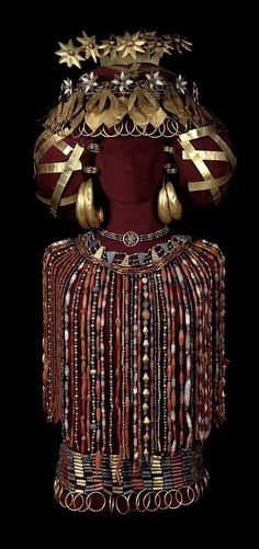 Queen Pu-abi, in all her regalia: Her jewelry weighed 14 pounds. This is a recent reconstruction (2009) of the queen's finery, done by the UPenn Museum.