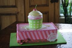 Pink and green birthday sheet cake with cupcake shaped tier