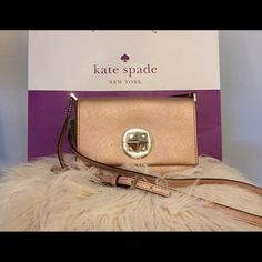 Kate Spade Rose Gold Newbury Lane Sally Brand New with tags. Rose Gold Kate Spade in excellent condition. Interior slide pocket, embossed Kate Spade on turnlock closure, and matching cross body strap.  Kate Spade shopping bag in picture is included. PRICE FIRM kate spade Bags Crossbody Bags