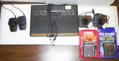 Atari 2600 Woodgrain Console, 2 joysticks, 2 paddle sticks, 2 game programs     http://cgi.ebay.co.uk/ws/eBayISAPI.dll?ViewItem=290858214846=STRK:MESE:IT    Vintage gaming set! 100% of proceeds go straight to charity!