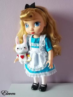 Disney animator doll Aurora dressed as Alice