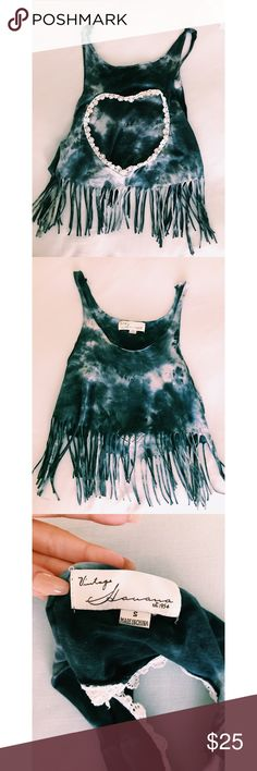 Open Heart Tie Dye Crop This crop top has fringe on the bottom with a heart on the back of the shirt. The heart is open exposing the back and lined with lace! Light weight and easily paired with anything! Vintage Havana Tops Crop Tops