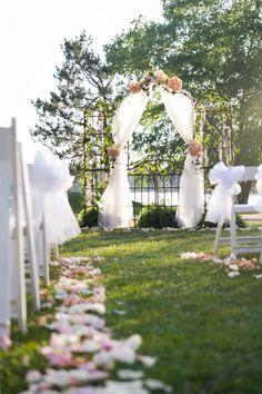 Wedding arch hydrangeas and moss