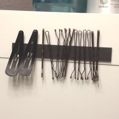 Magnet tape to hold hair clips, bobby pins. #bathroom organization# storage