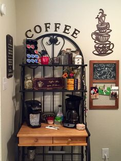 Coffee bar in a small apartment with decor from hobby lobby and a bakers rack