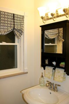 Super Easy No-Sew Curtain/Valance:  for $2.50, an iron, some hem tape (I think that is what it is called), scissors and a measuring tape you can create a cute little valance in a snap.  It really is easy, anyone can do it.