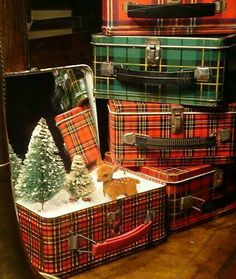 Cute idea to put my Christmas village in a suitcase with a mirror on the lid...