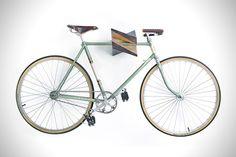 """Oak Wood Bike Hanger """"Iceberg"""" by Woodstick Ltd. I need something to hold up my fixie! Home Bike Rack, Indoor Bike Rack, Diy Bike Rack, Bicycle Storage, Bicycle Rack, Bicycle Stand, Bicycle Wall Hanger, Wall Mount Bike Rack, Bike Mount"""
