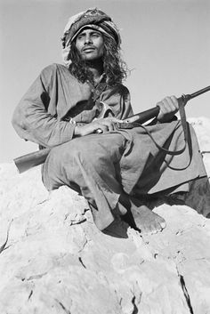 Portrait of Bedouin man Salim bin Ghabaisha holding a rifle. United Arab Emirates, 1950. Photo by Wilfred Thesiger. (Pitt-Rivers Museum)