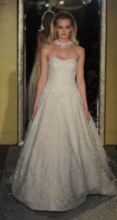 Strapless ballgown with beading embellishments | Oleg Cassini at David's Bridal Spring 2017 | https://www.theknot.com/content/oleg-cassini-davids-bridal-bridal-fashion-week-spring-2017