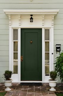 front doors images -love the small wood covering above the door.  This would work well on my back door.