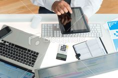 Businessman at his desk using a digital tablet Royalty Free Stock Photo 24511369