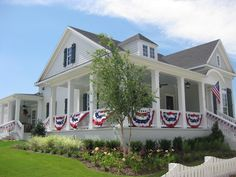 Lots of flag bunting adorns this patriotic porch in Tucker Hill (McKinney, TX) www.tuckerhilltx.com