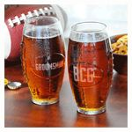 Our Custom Glass Football Tumblers make an ideal addition to any tailgater's or sports fan's barware collection. With their contoured frame and chiseled gridiron look, these football styled glasses are uniquely fun toasting treats for all the fans on your list. Featuring hand blown glass structured as an actual NFL pigskin, these masculine glasses become an instant keepsake when you add on three block initials and a line of custom text to each of their shapely sides.
